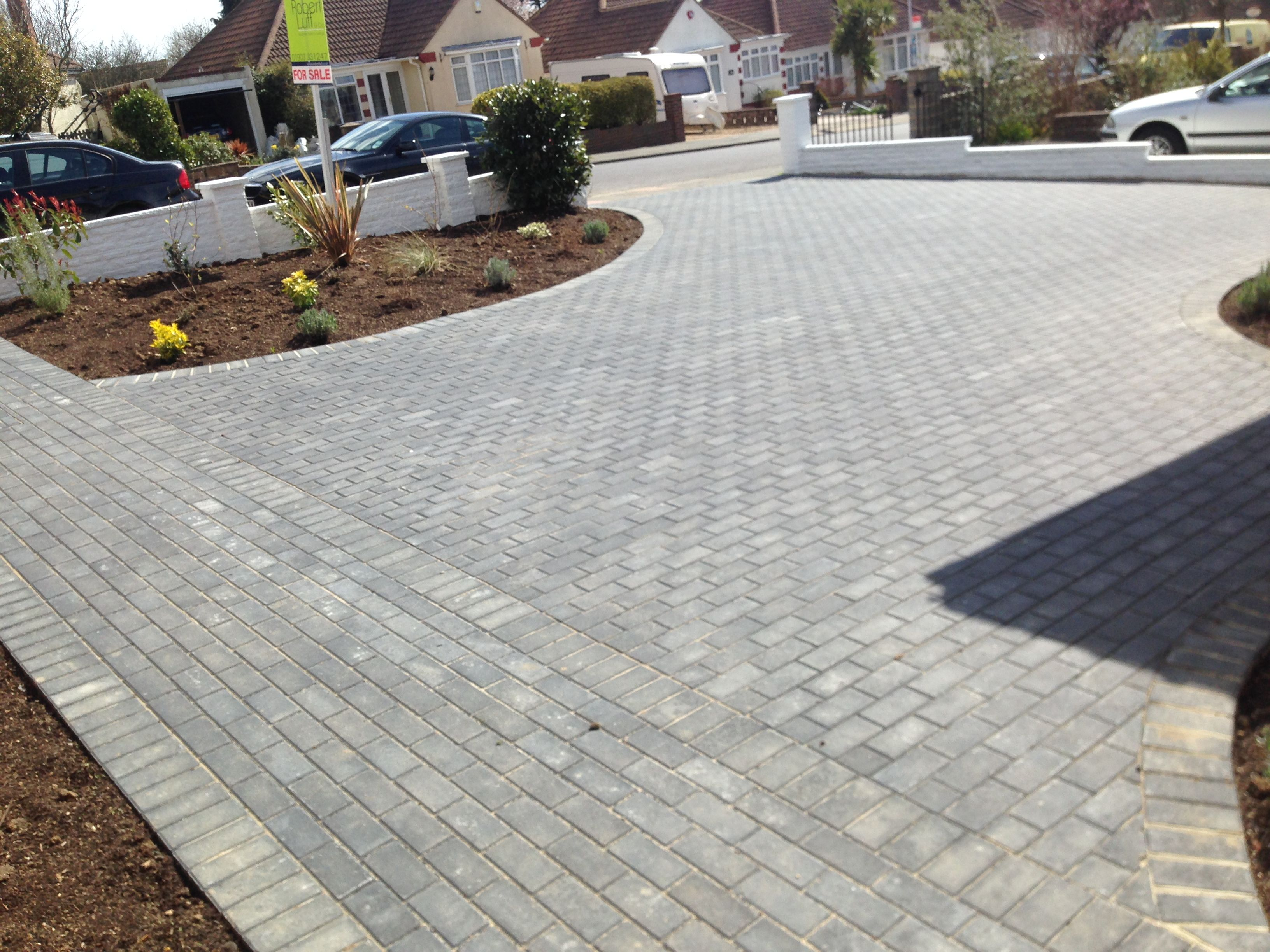 Charcoal block paving driveway finished with planting