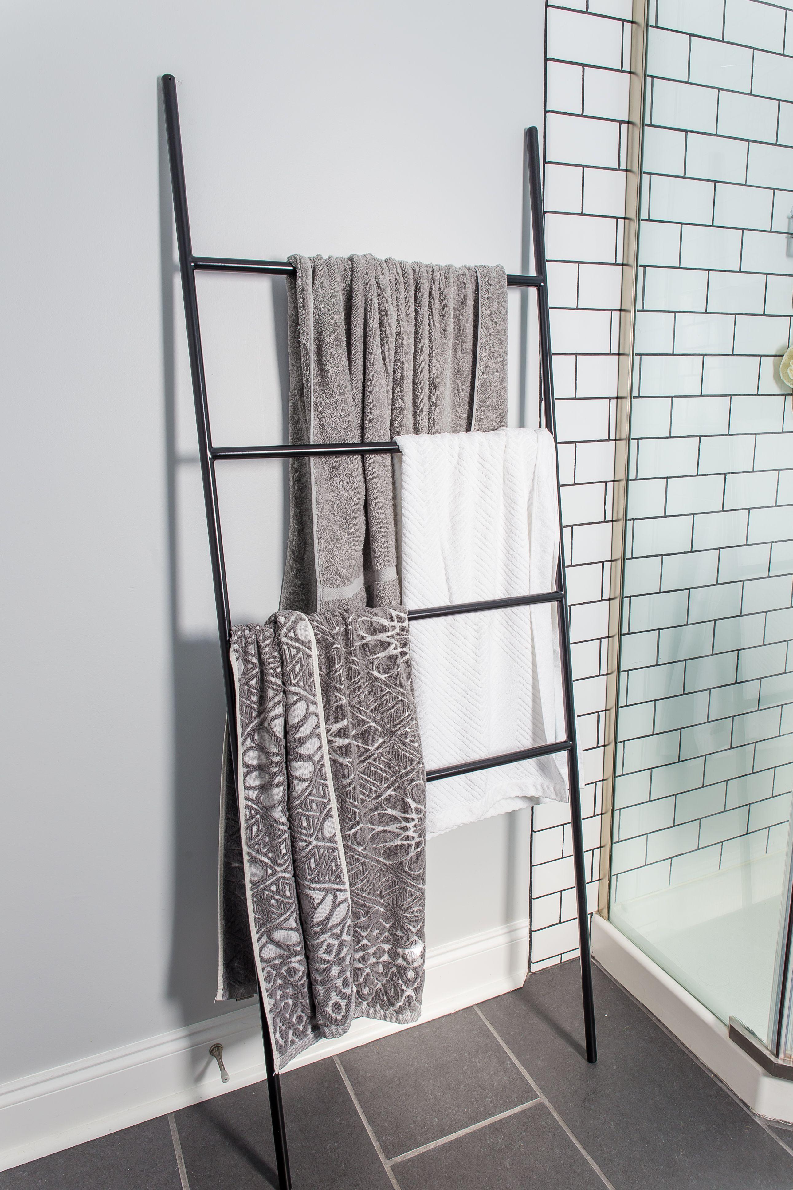 DIY bathroom remodel. Grey walls, black tile floors, subway tile ...