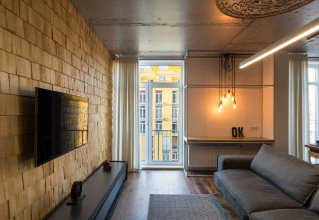 luminaire industriel plafond en b ton brut et casier bouteilles en bois dans un appartement. Black Bedroom Furniture Sets. Home Design Ideas