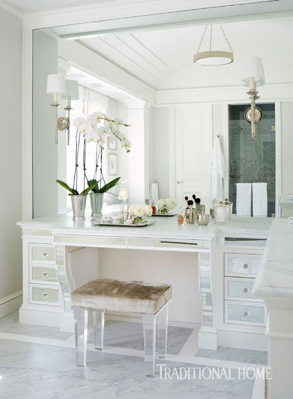 Mirrored drawer fronts and a Lucite bench add sparkle to the vanity area of the master bathroom. - Photo: John Merkl / Design: Kendall Wilkinson