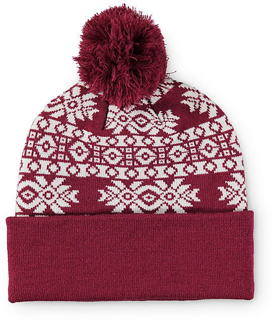 eb70a27dc82 A cozy and comfortable pom beanie made with a tight ribbed knit  construction in a trendy Aztec print is finished with a contrast solid cuff  and pom pom at ...