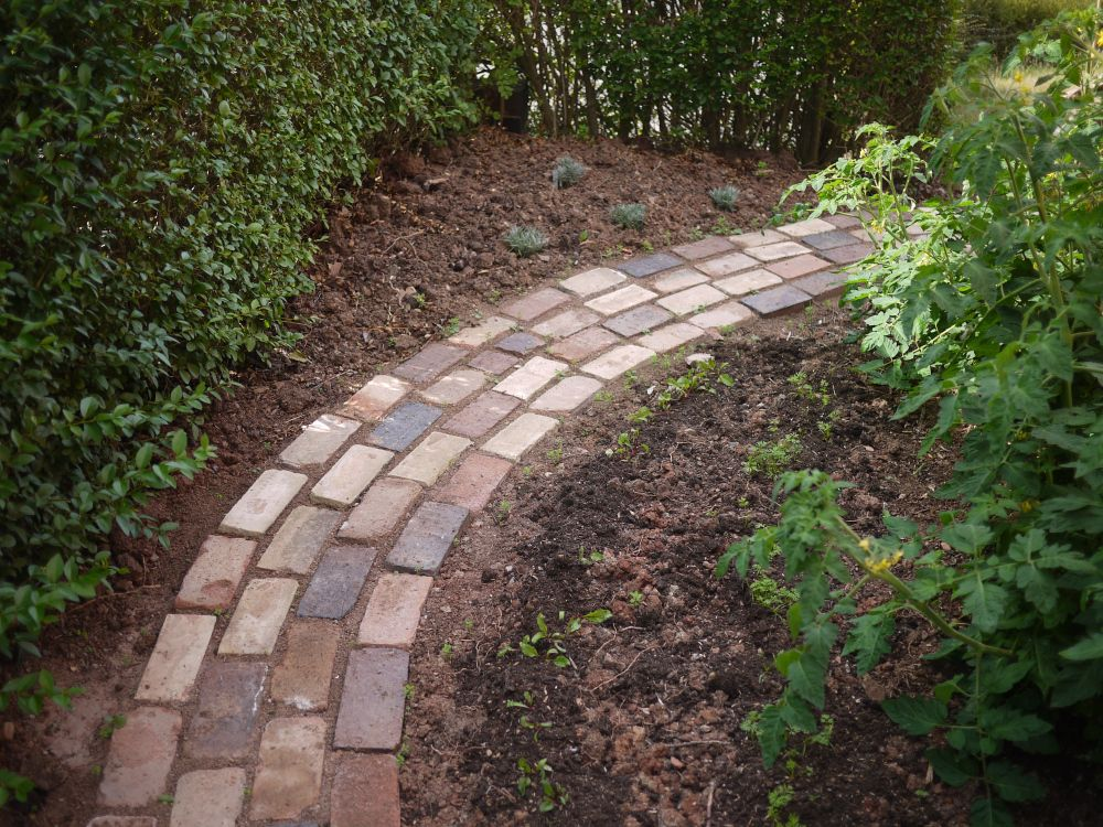 A garden path made from reclaimed bricks renovation for Garden path