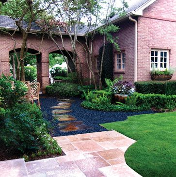 outdoor landscape wish slate stone walkway through stones borders on grass and travertine