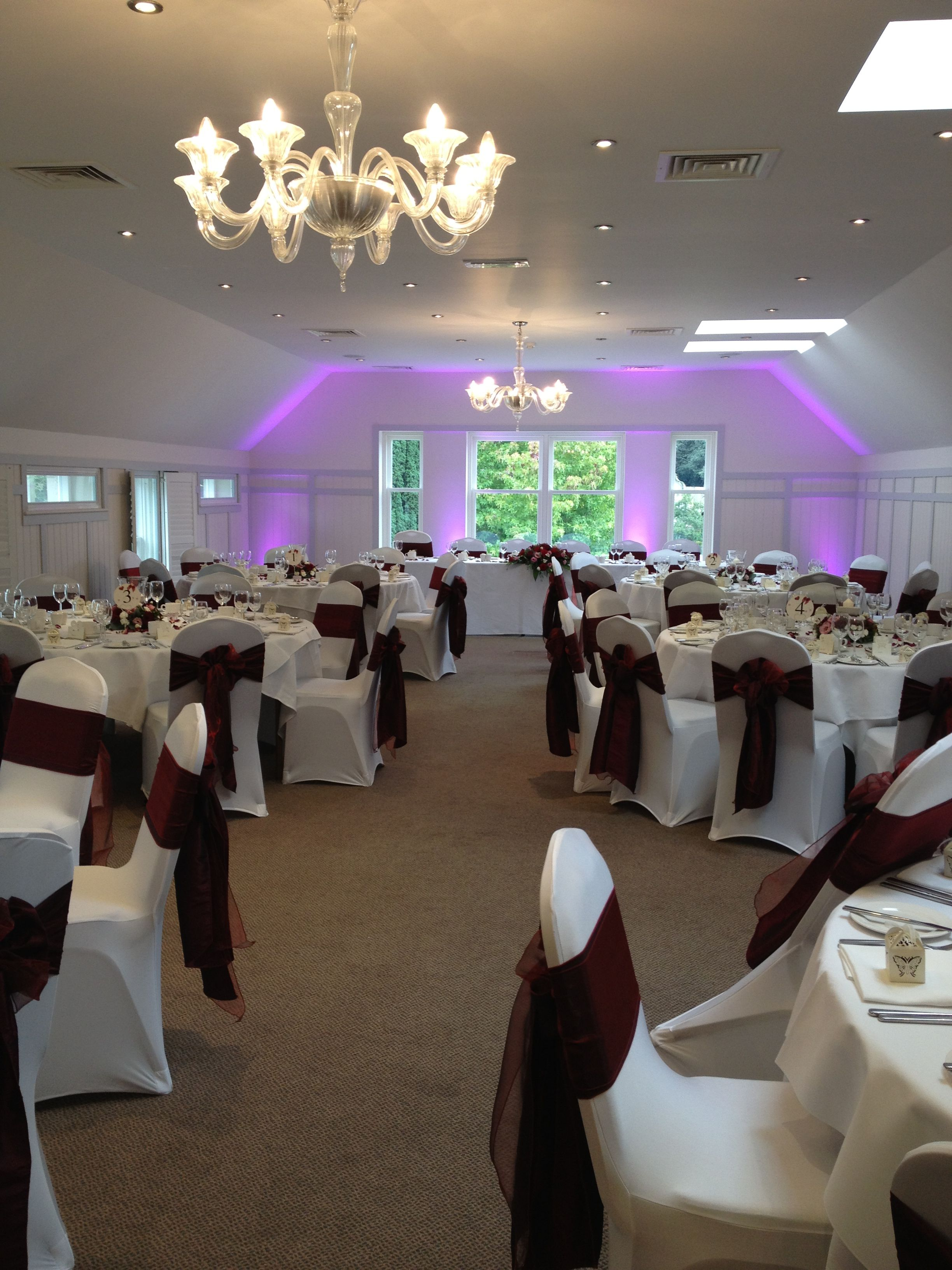 burgundy chair covers wedding tall dining room a traditional british breakfast set up with deep red wine and white sashes funky lilac uplighters