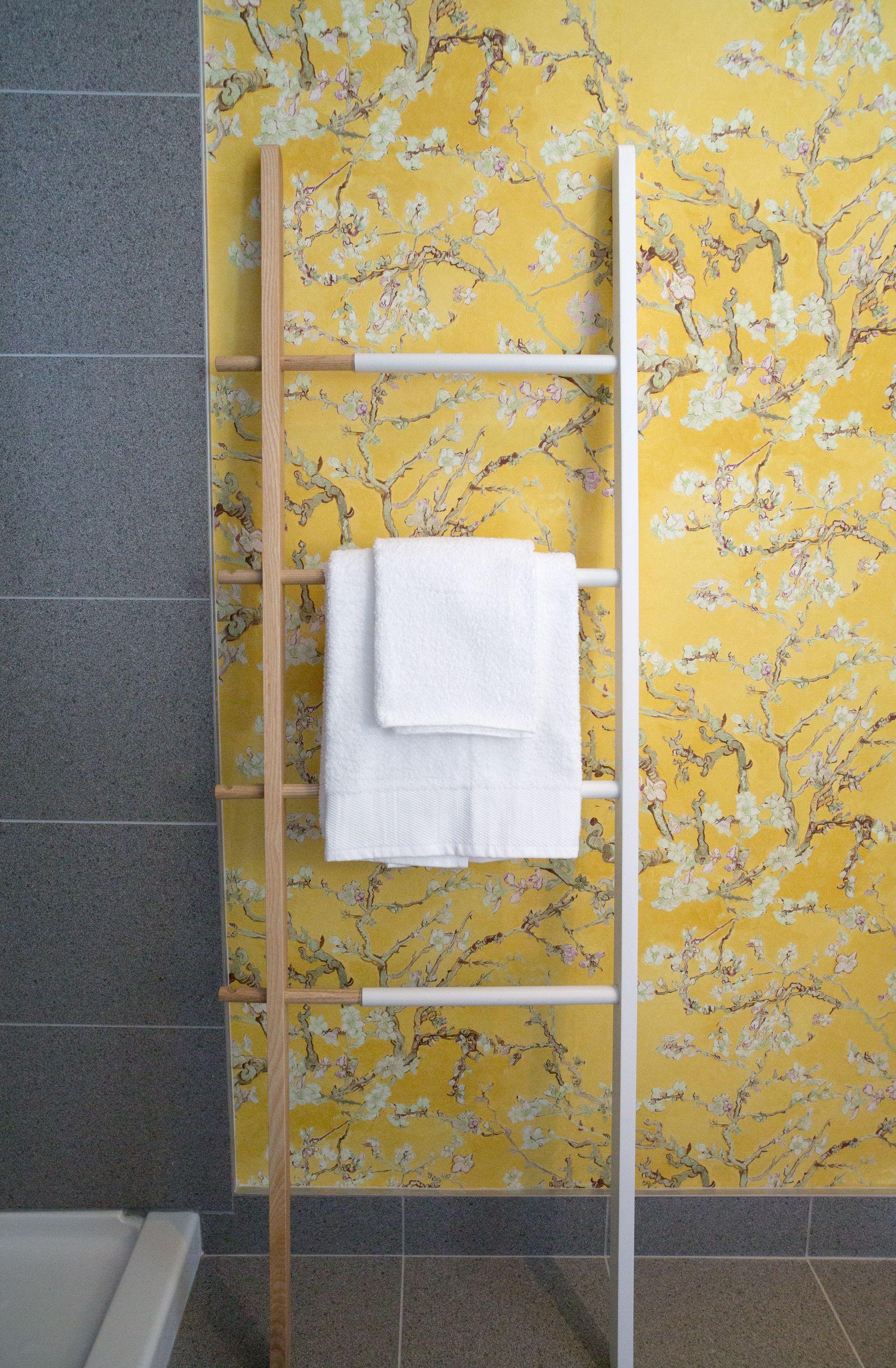 umbra hub ladder used to hang towels in ashley freeman designed small bathroom