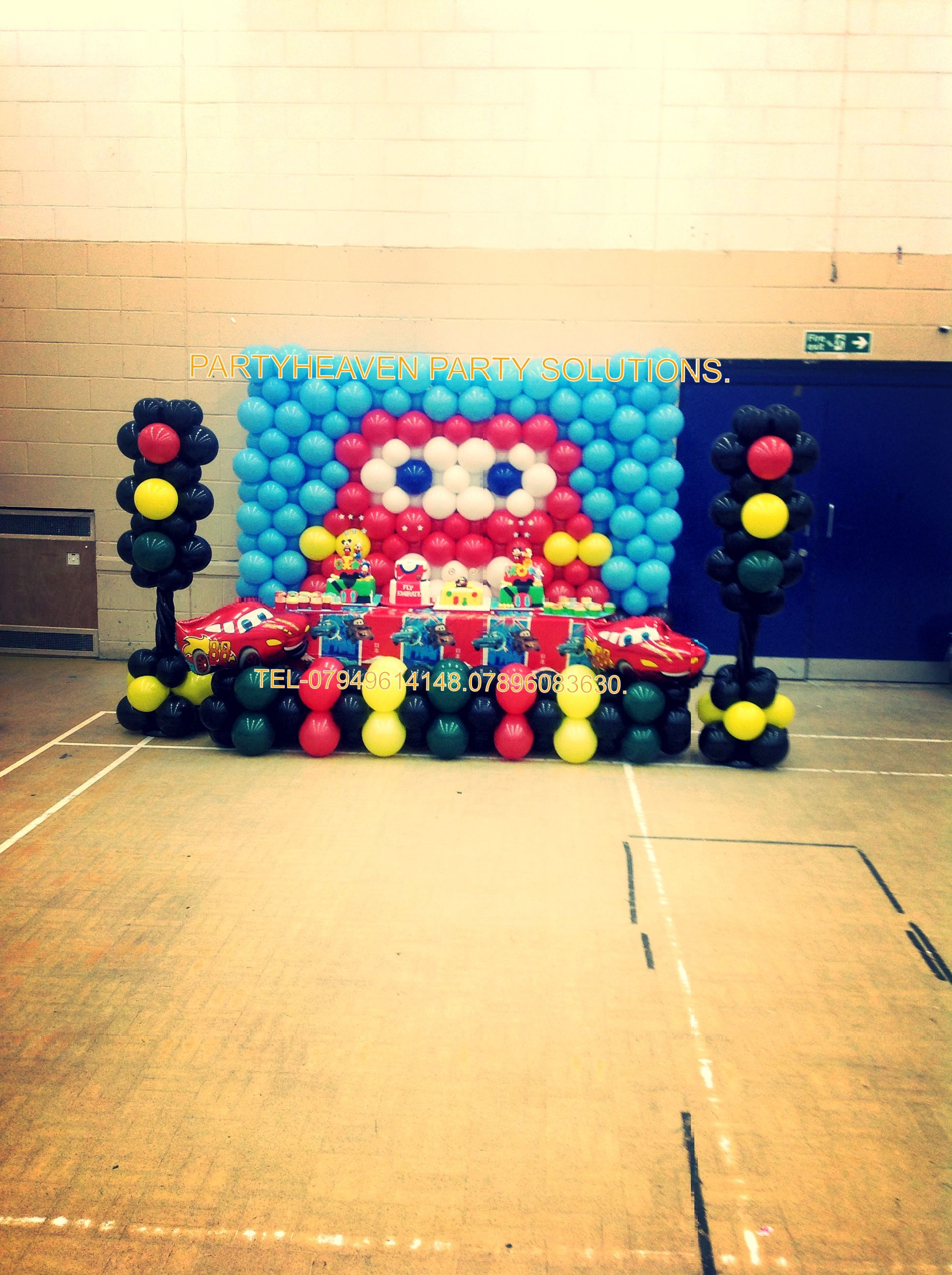 cars themed balloon decor with traffic lights balloon