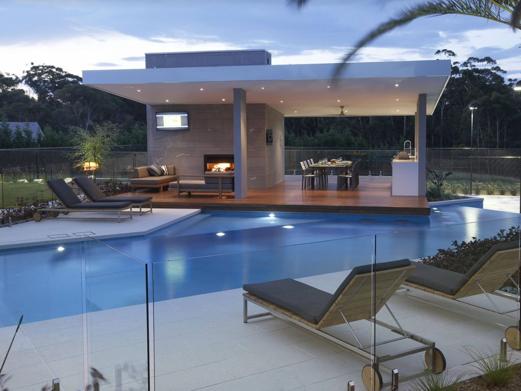 Contemporary Swimming Pool With Outdoor Pizza Oven, Outdoor Kitchen,  Exterior Stone Floors, Raised