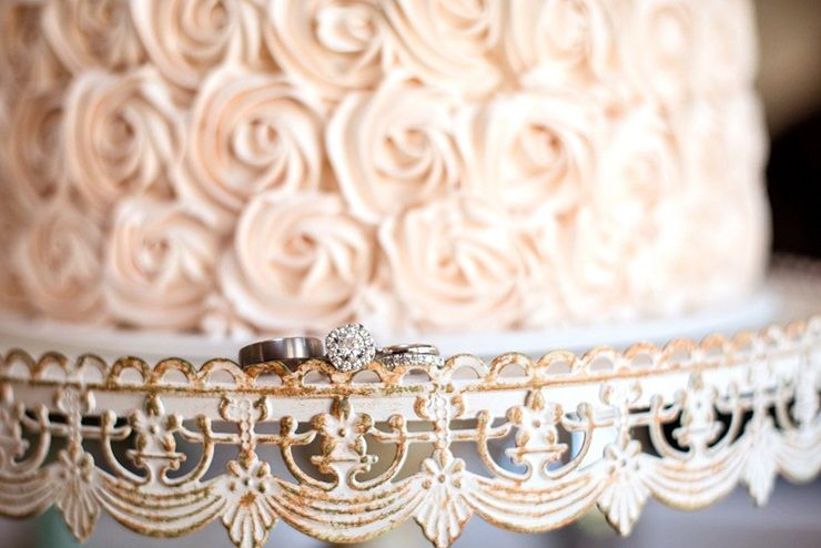 Wedding rings + wedding cake on vintage styled cake stand | itakeyou.co.uk
