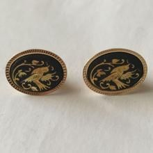 Gold plated with black enamel oval shape earrings with push backs and bird design from front side