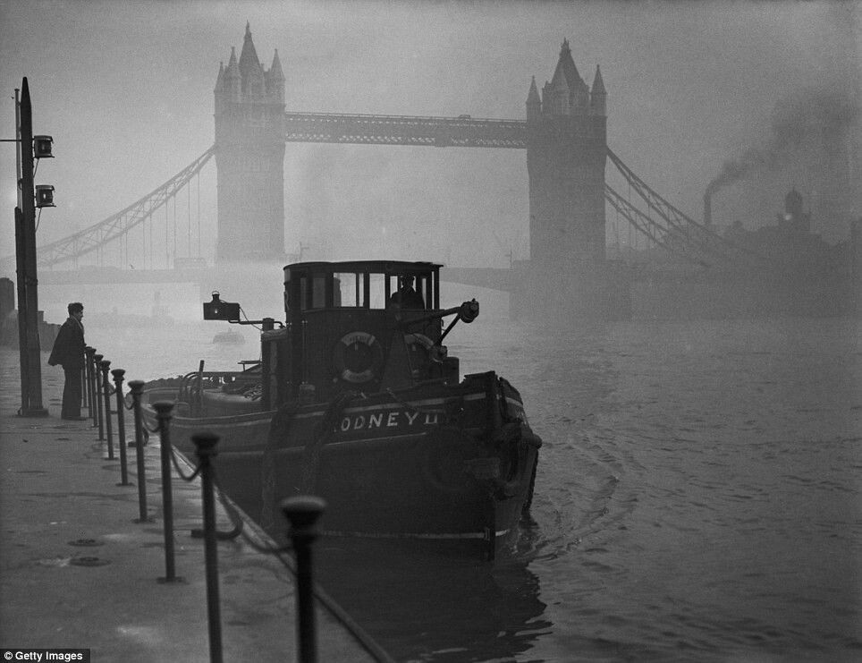 Iconic landmark: A tugboat docked on the Thames near Tower Bridge during heavy smog in December 1952