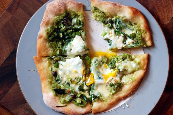Garlic Scape-Pesto Pizza When you get bored with your go-to pizza, try this gorgeous green alternative from Not Derby Pie, made with homemade pesto, asparagus, and egg.