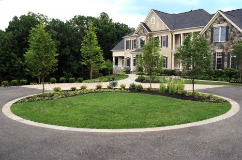 Circular Driveway With Green Grass And Tree In The Center Driveway Design Circle Driveway Landscaping Contemporary Landscape Design