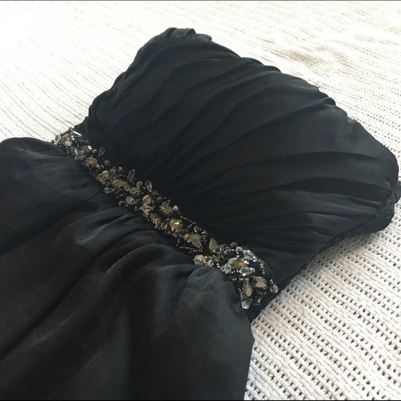 Strapless Black Dress Beautiful black strapless with jeweled detailing on the waist. Worn once, perfect condition Mustard Seed Dresses Strapless