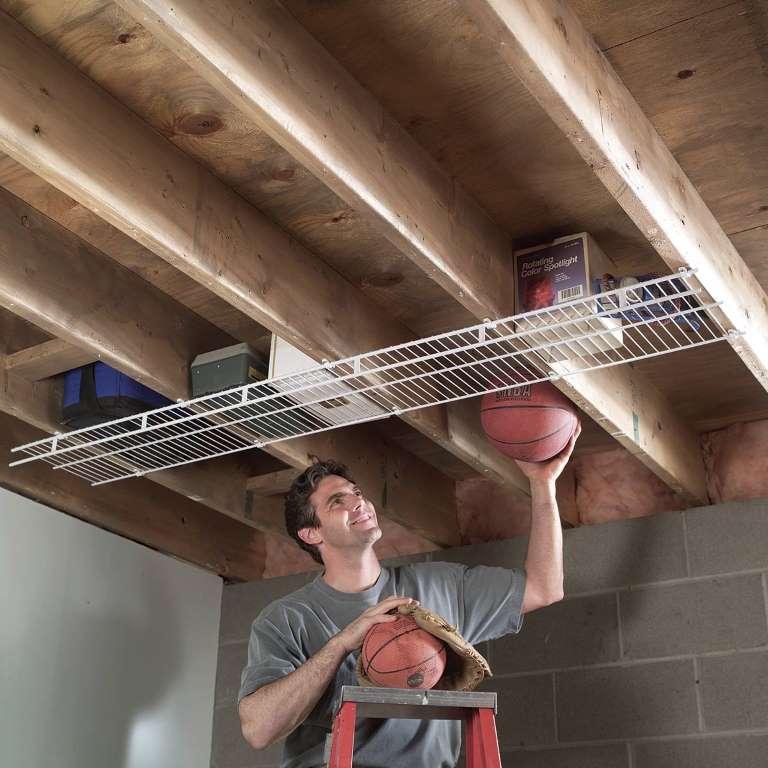 under joist shelf provided by the family handyman on new garage organization ideas on a budget a little imagination id=44192