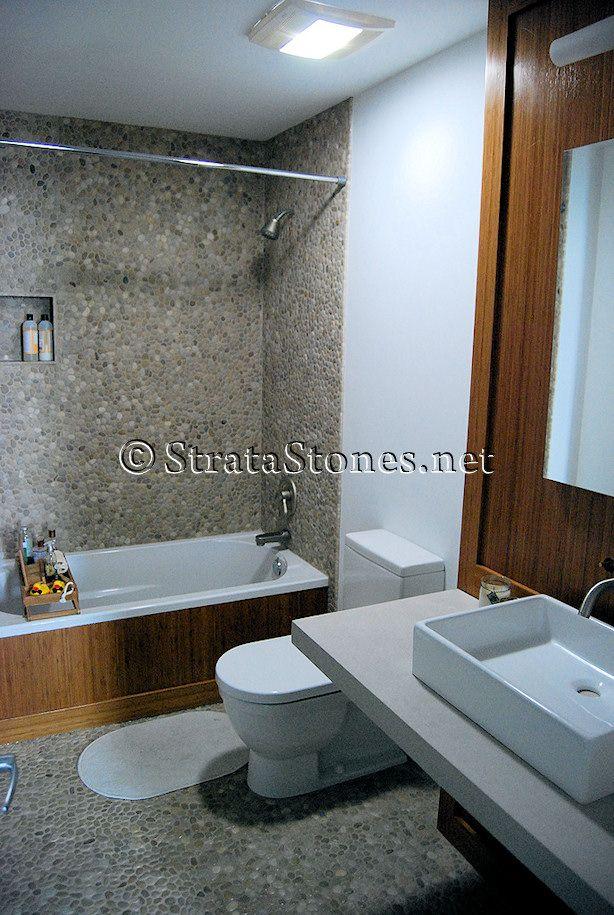 Tan Pebble Tile Bathroom Flooring And Shower