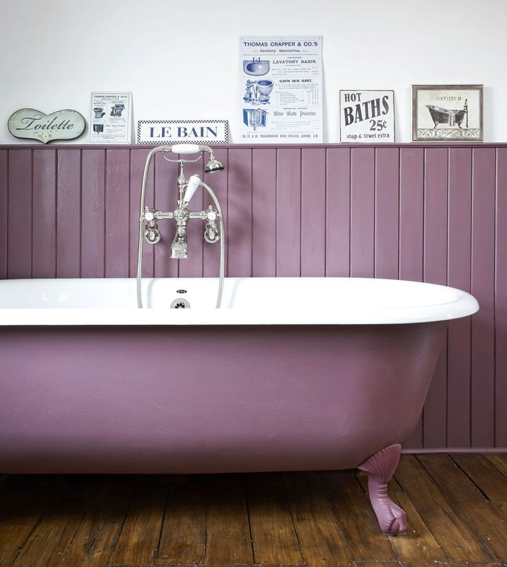 Plum paint updates a vintage, cast iron tub for stylish, laid-back style.