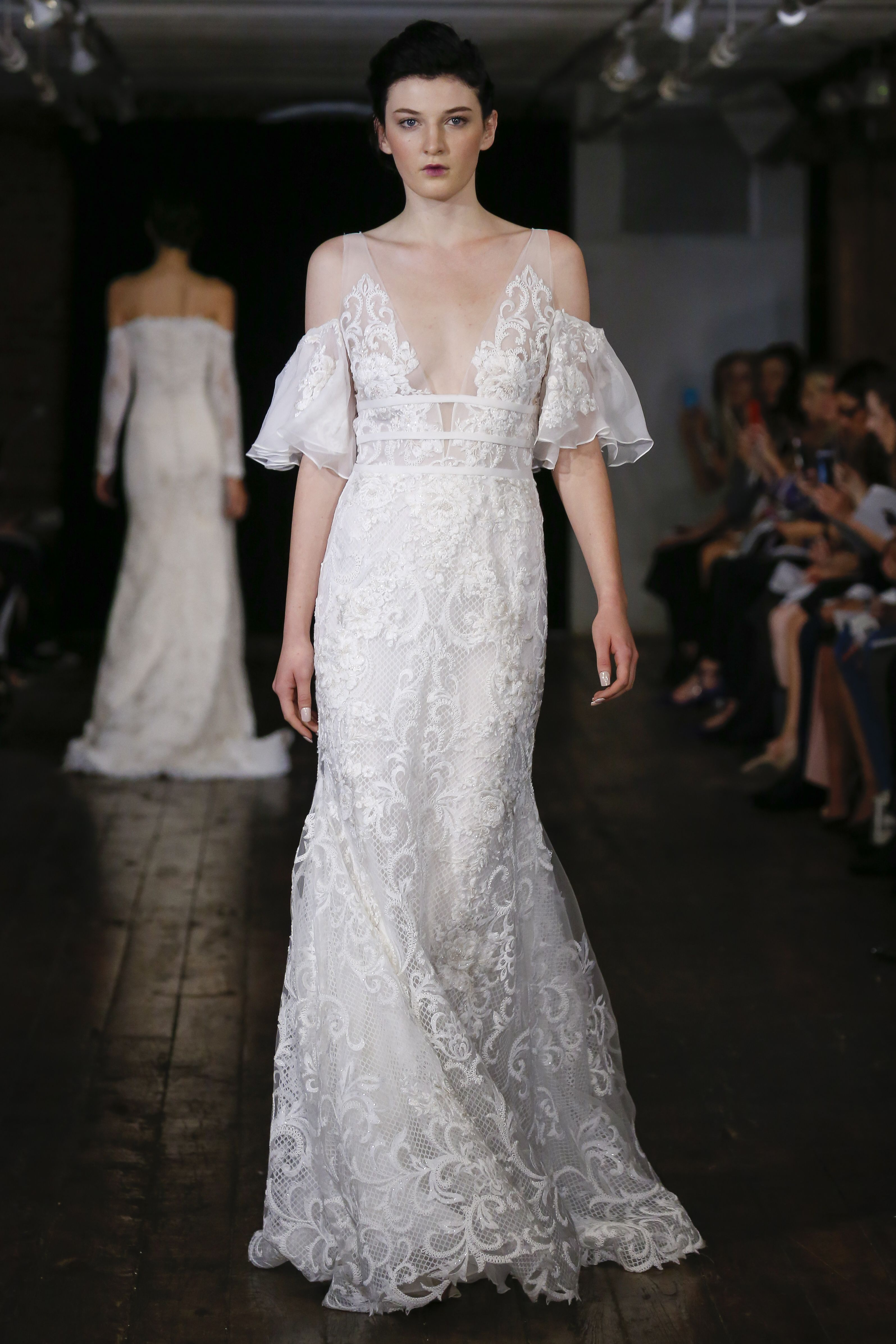 Flowy wedding dress with sleeves  Lace wedding dress from the FallWinter  Rivini Collection from