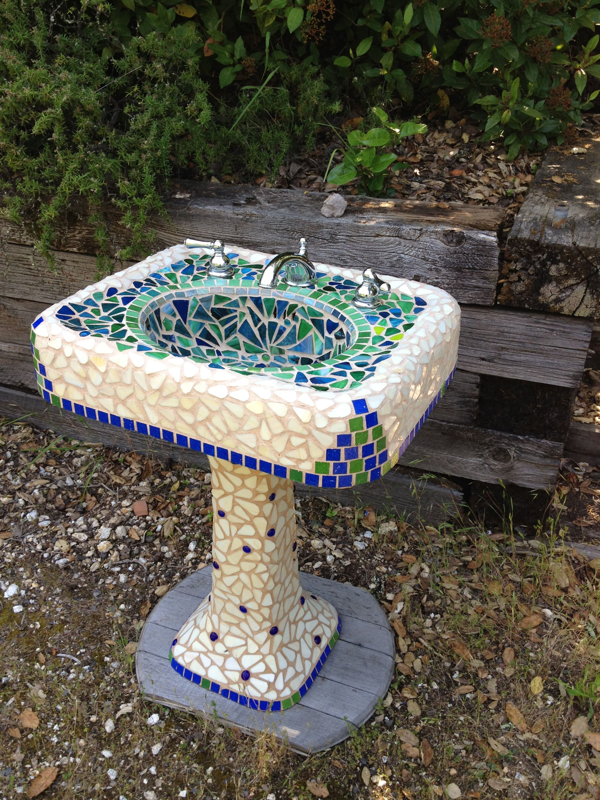 Mosaic sink made with stained glass and tile made by Susan Long