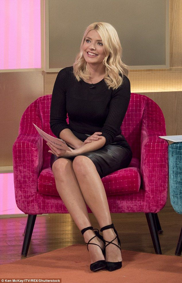 Sitting pretty  Holly WIlloughby looked stunning in a black leather pencil  skirt and ribbe. c70db9ffc