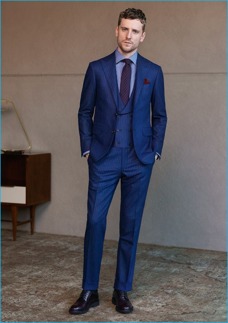b971be1adbde87 George Barnett dons a navy three-piece pinstripe suit from Canali's  fall-winter…