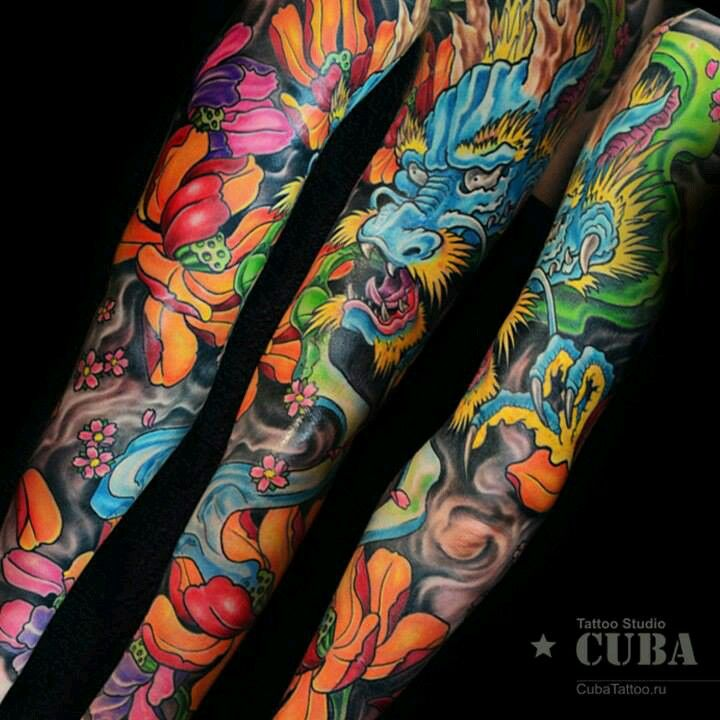I M Digging This Vibrantly Colored Japanese Dragon Tattoo Sleeve I Like How The Color Pops Out An Dragon Sleeve Tattoos Sleeve Tattoos Japanese Sleeve Tattoos