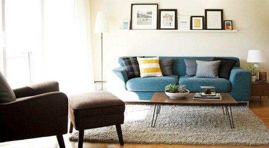 Lovely take on mid-century mod, especially the coffee table and chair/ottoman.