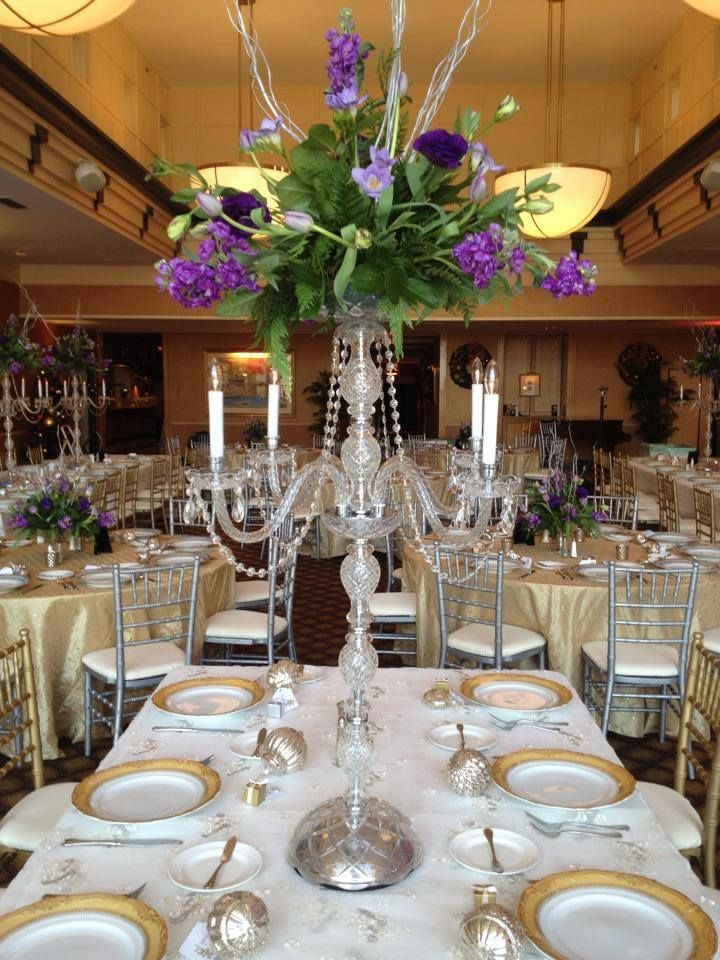 Crystal candelabra centerpiece rental with fresh flower