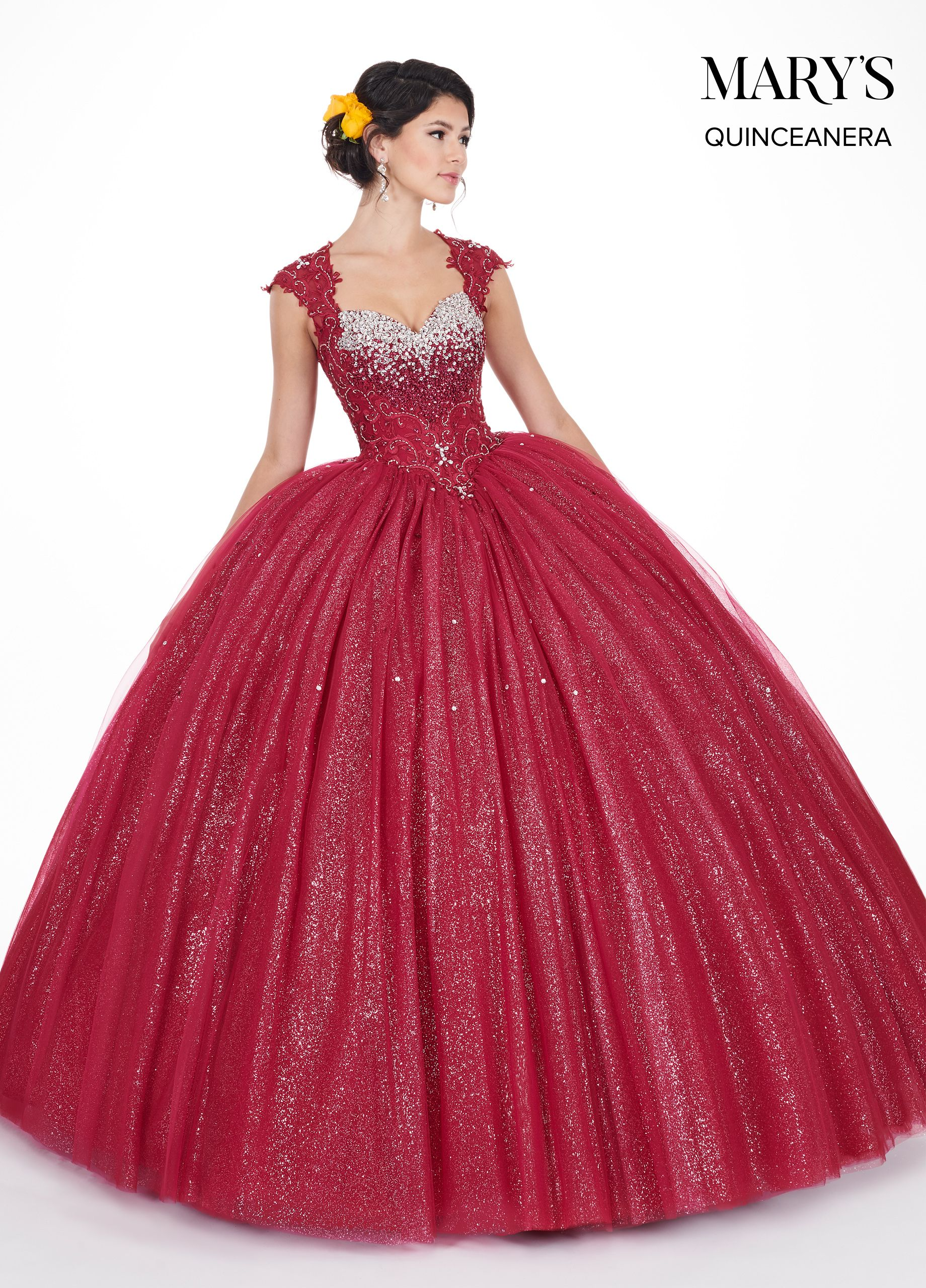 2c8f3455996 Dramatic glitter tulle gown with an embroidery applique bodice ...