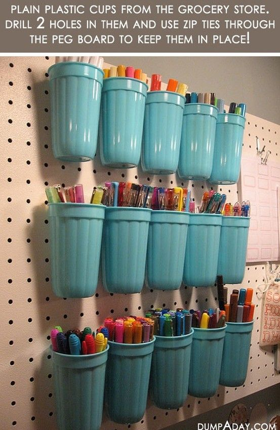 Great idea for the boy's rooms. Get's the clutter of pens/markers/crayons off the floor and off the tables.