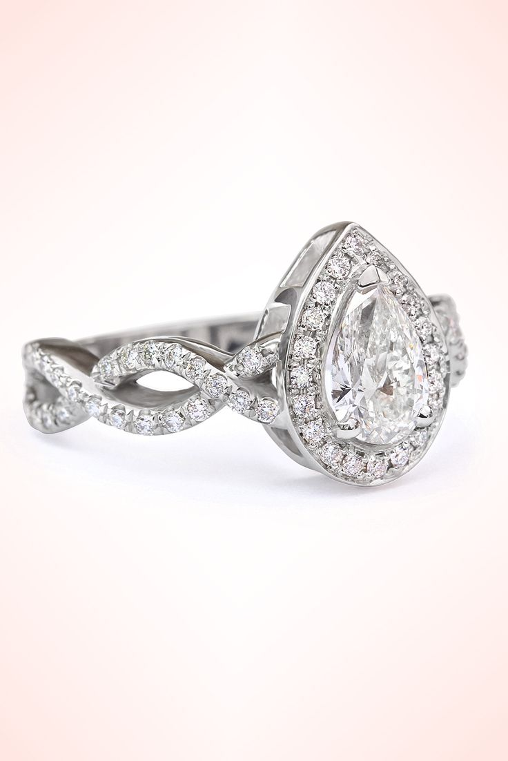 engagement ring cathedral diamond in pin twist infinity gold white