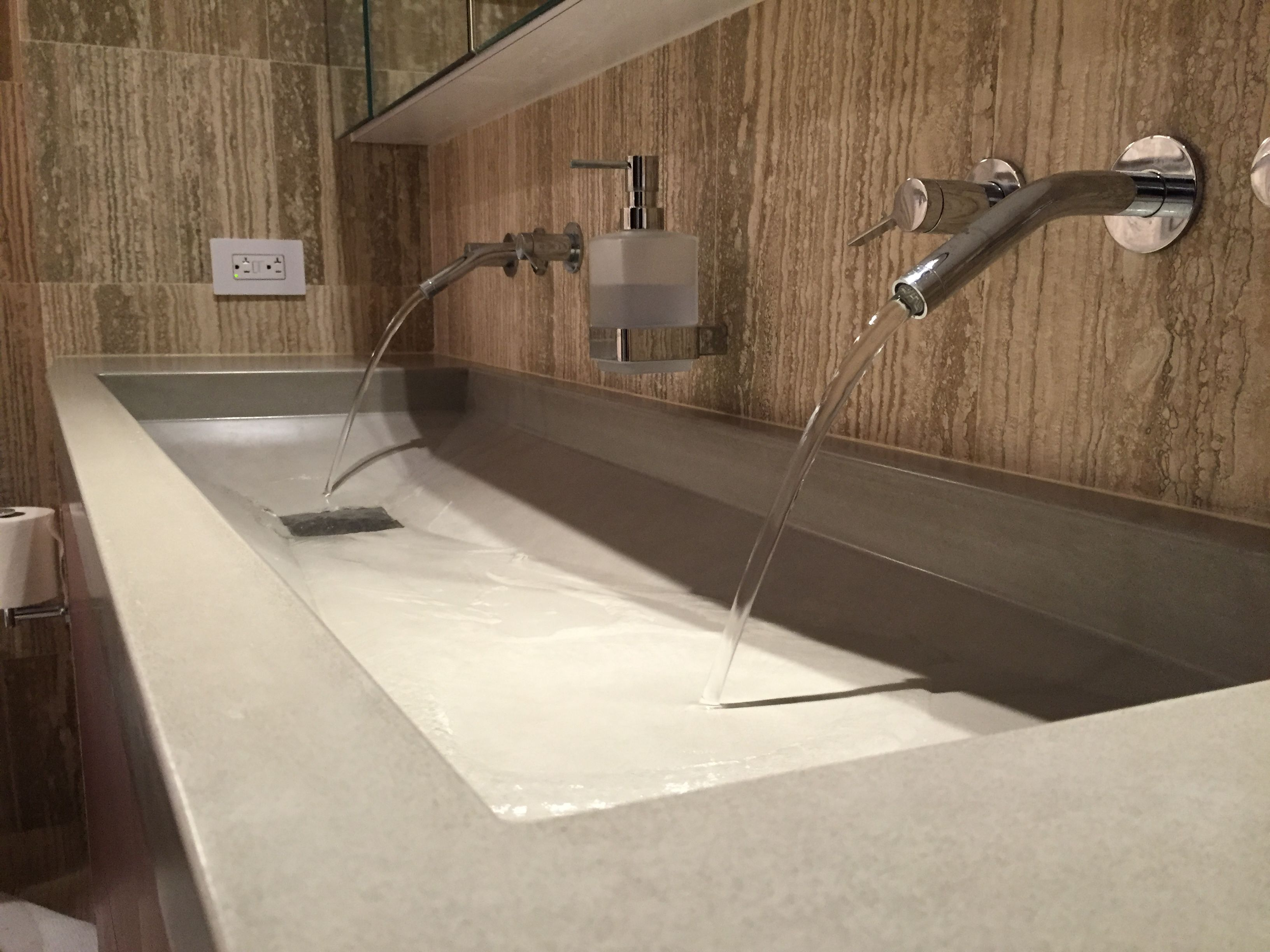 custom concrete sink by Trueform Concrete with wall mount faucets