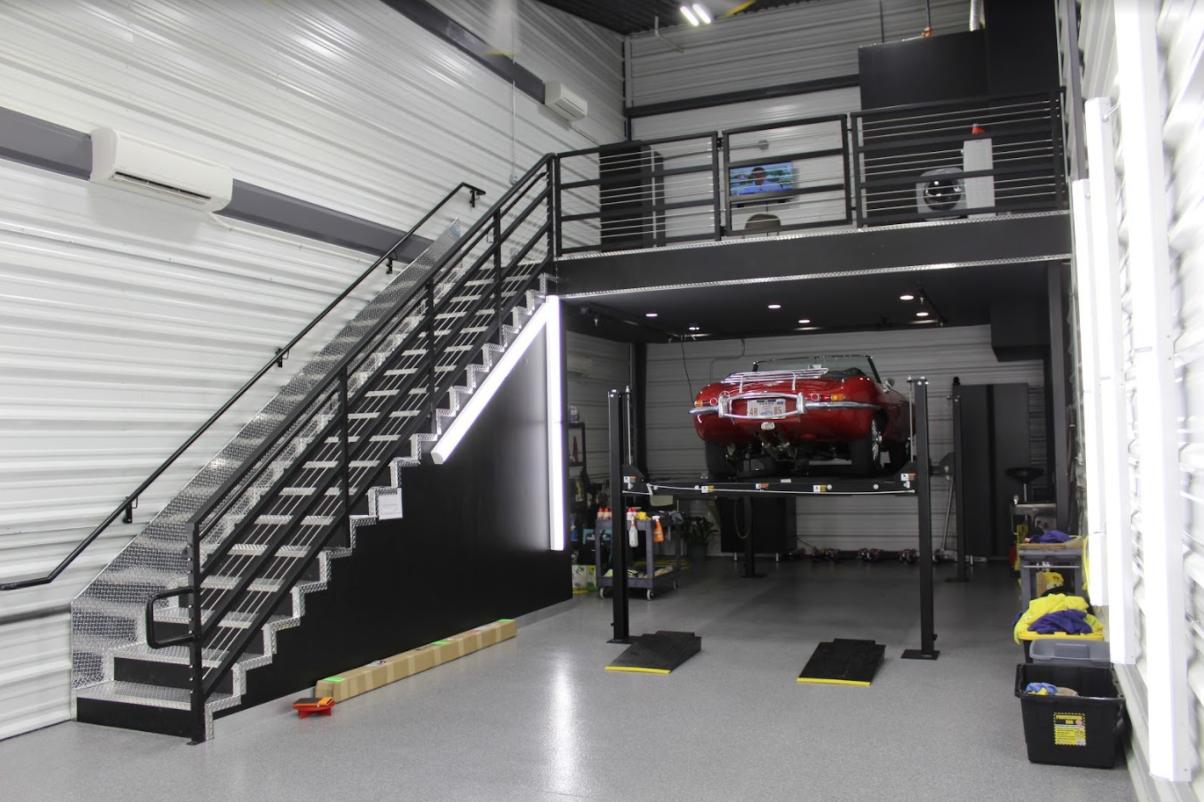 When A Car Lift Doubles As A Pedestal Luxury Garage Garage Door Design Garage Design