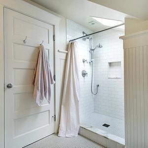 JAS Design Build - bathrooms - cottage bathroom, beadboard bathroom, white beadboard bathroom, yellow walls, white and yellow bathroom, yellow walls, yellow bathroom walls, attic bathroom, attic shower, eaves shower, shower skylight, subway tile, subway tile shower, subway tile shower surround, shower niche, subway tiled niche, penny til, penny tile floor, penny shower floor, penny tile shower floor, vintage penny tile,