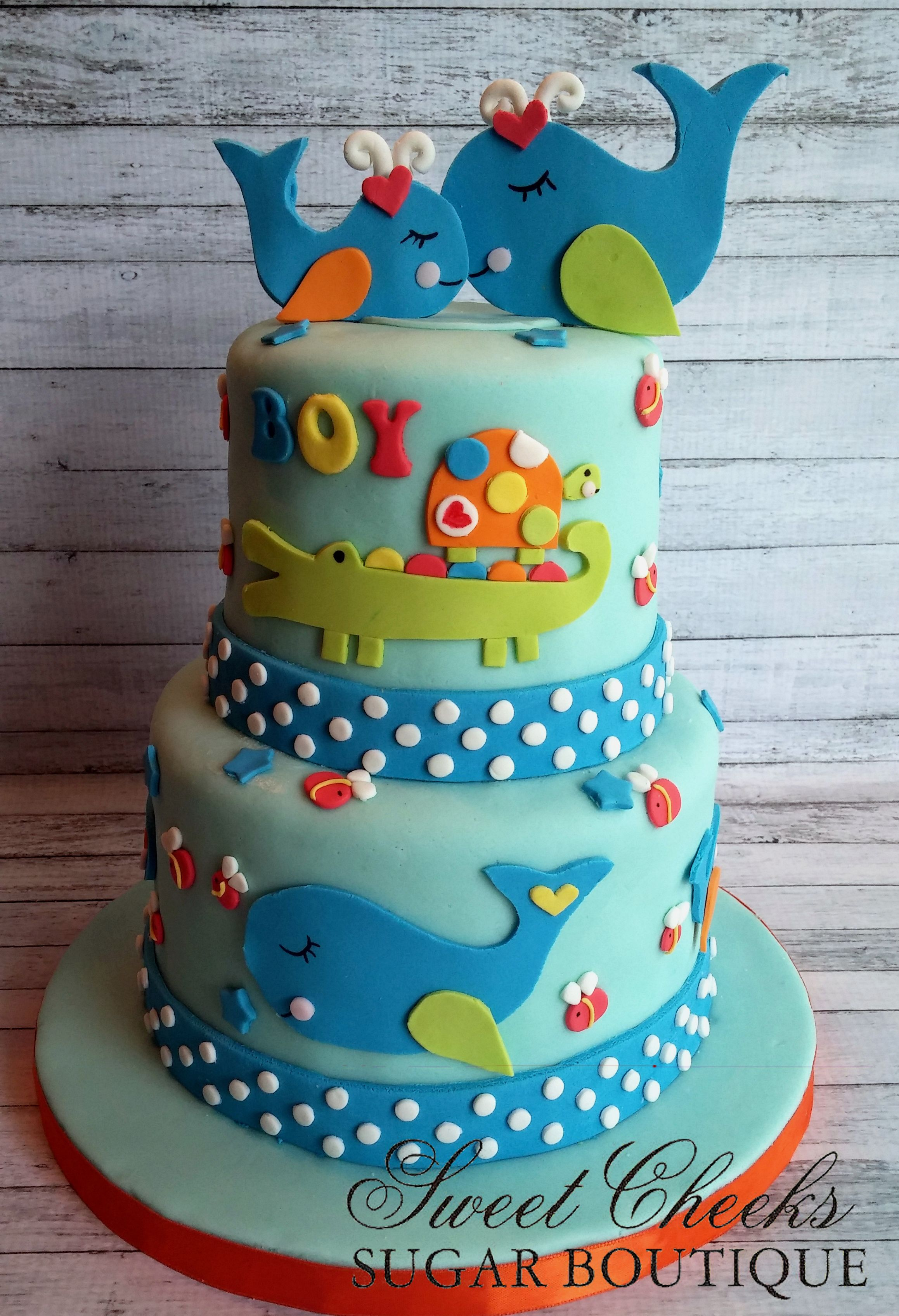 Ocean themed baby shower cake with turtles whales submarines and