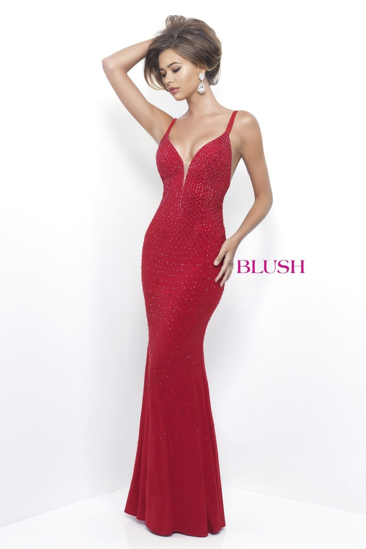 This form fitting dress will turn heads with the low back and ...