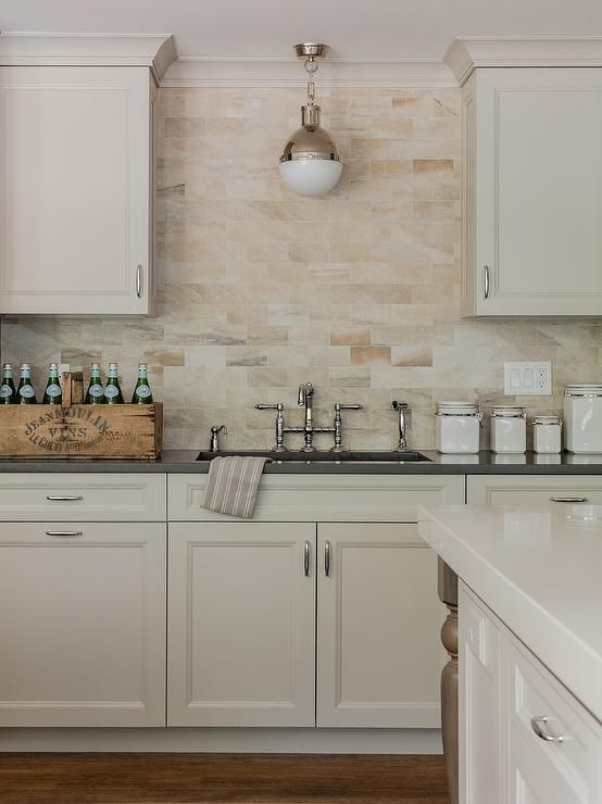 A Small Hicks Pendant Is Mounted In Front Of Tan And Orange Brick Top Preeminent White Gl Subway Tile Kitchen Backsplash Menards Grey Cream