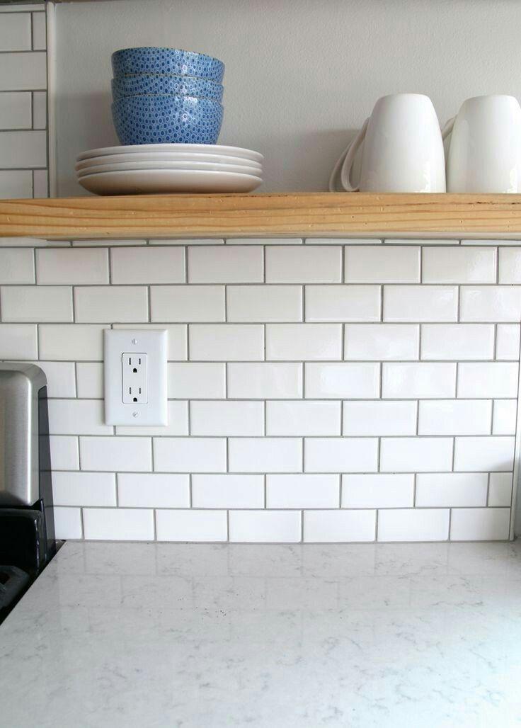 White Subway Tile Dark Grout And Quartz Looks Like Avenza