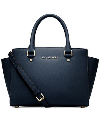 Luxe Saffiano leather shapes this smart satchel with discrete gussets and signature detailing. With multiple interior compartments and a convenient crossbody strap, the sleek rolled handles offer an e