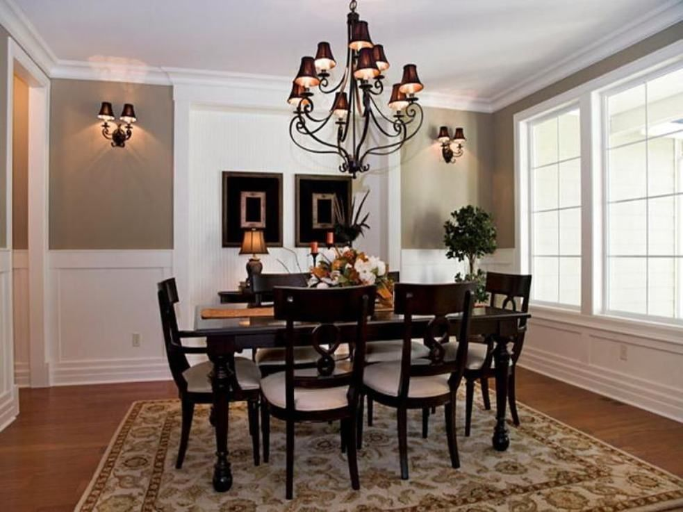 Traditional Dining Room Using Light Wall Colors Featured Wainscoting And Wall  Sconces And Furnished With Black Furniture Under Chandelier With Black  Shades