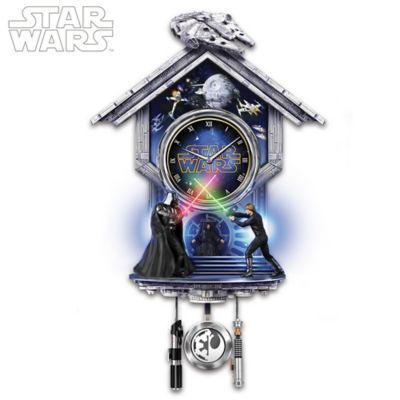 Limited-edition STAR WARS clock captures lightsaber duel from Return of the Jedi with sculptural figures, colored illumination and movie theme song.