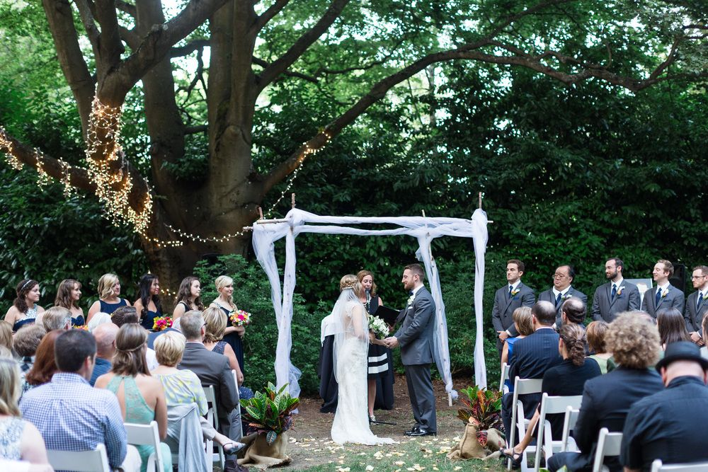 Outdoor Ceremony String Lights In Tree Seattle Washington Wedding Photographer Woodland