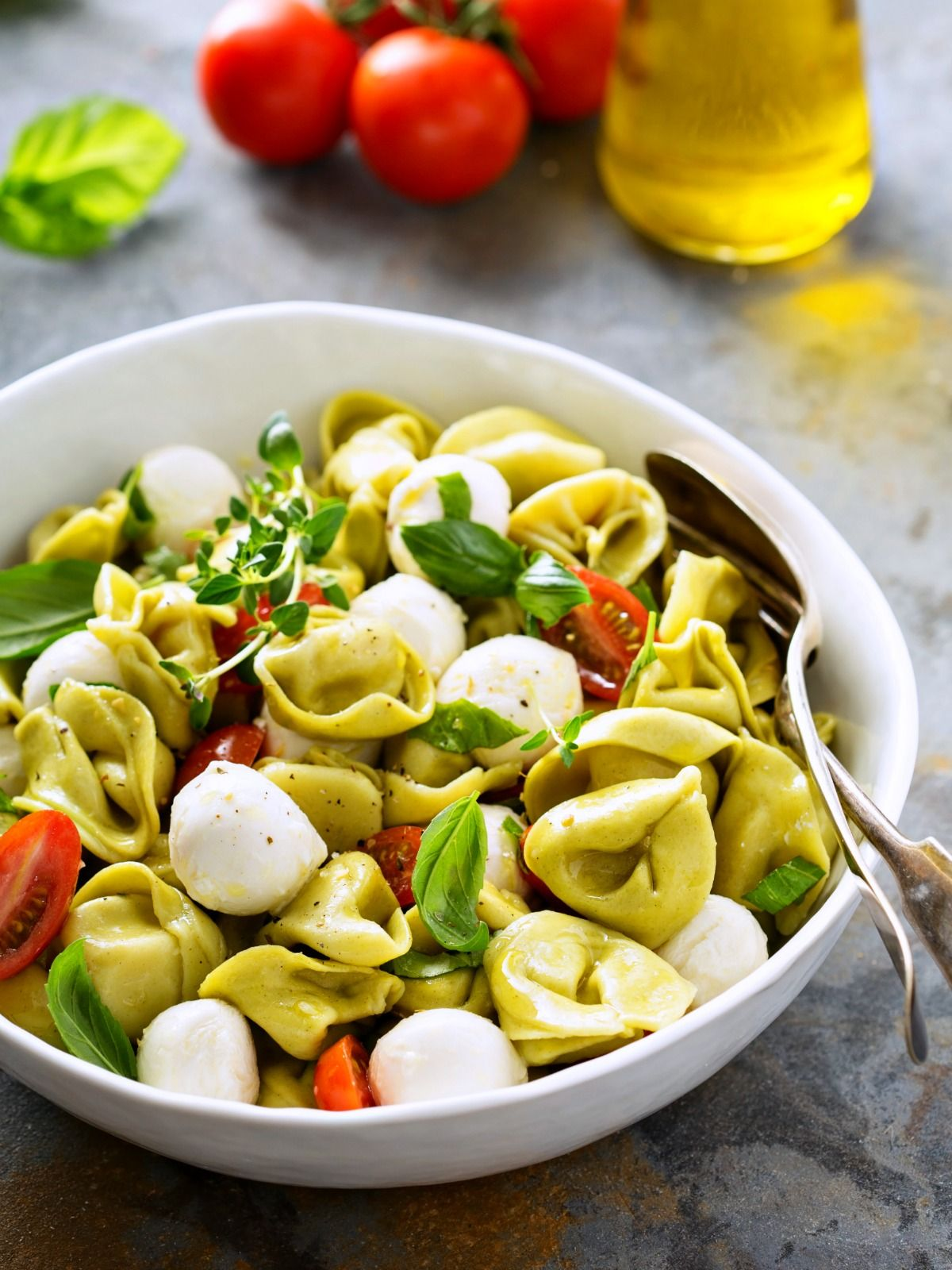 This fresh, easy, and filling Tortellini Pasta Salad with Caprese flavors makes a quick vegetarian dinner or side dish! #pioneerwomannachocheesecasserole