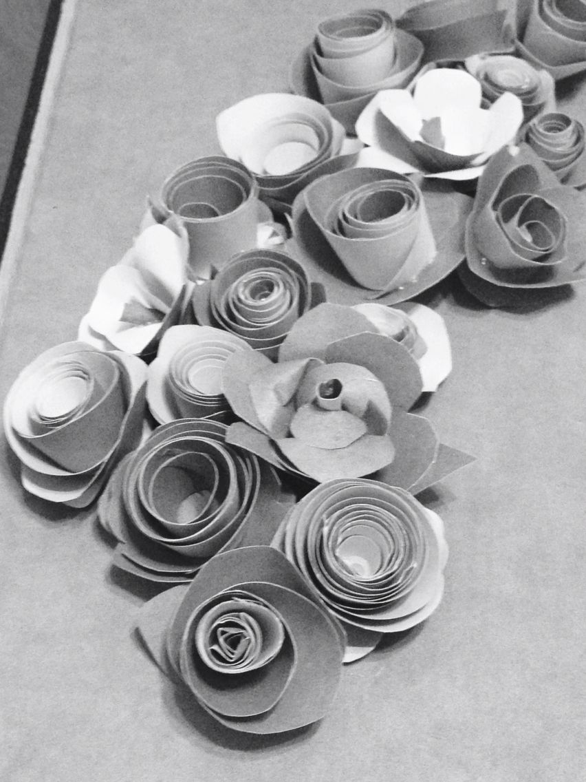 Hand made flowers glued to the lid of a blanket box to use as a present box