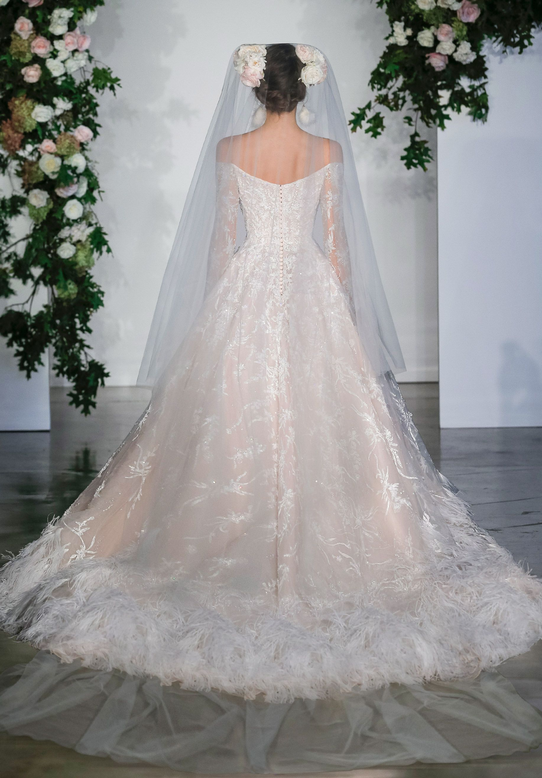 Delicate beading accents the textured embroidery on the tulle