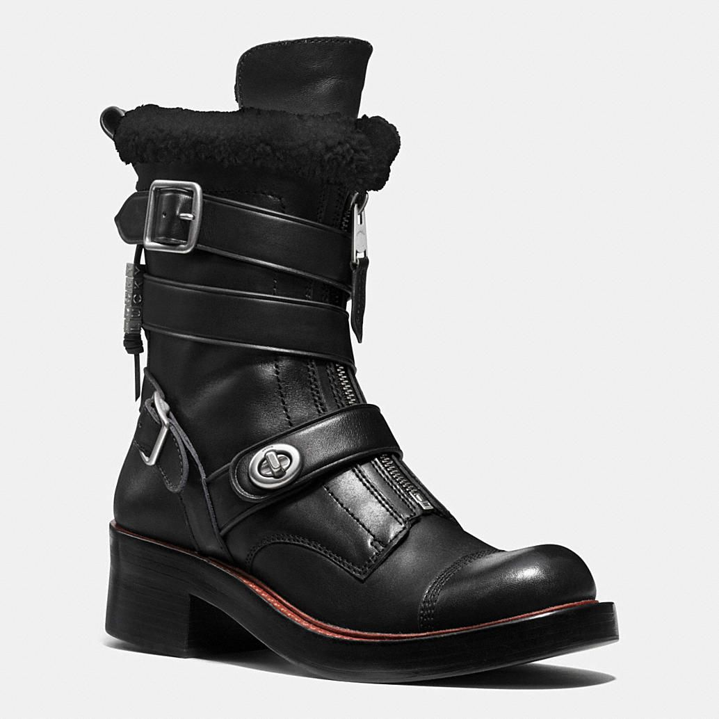 Inspired by vintage tanker styles, this subversively chic boot combines the toughness of moto style with the refinement of heritage craftsmanship. Worked by hand in vegetable-tanned leather, this statement cold-weather design is trimmed with buckles and turnlocks, plush shearling and charms inspired by biker gang nicknames.