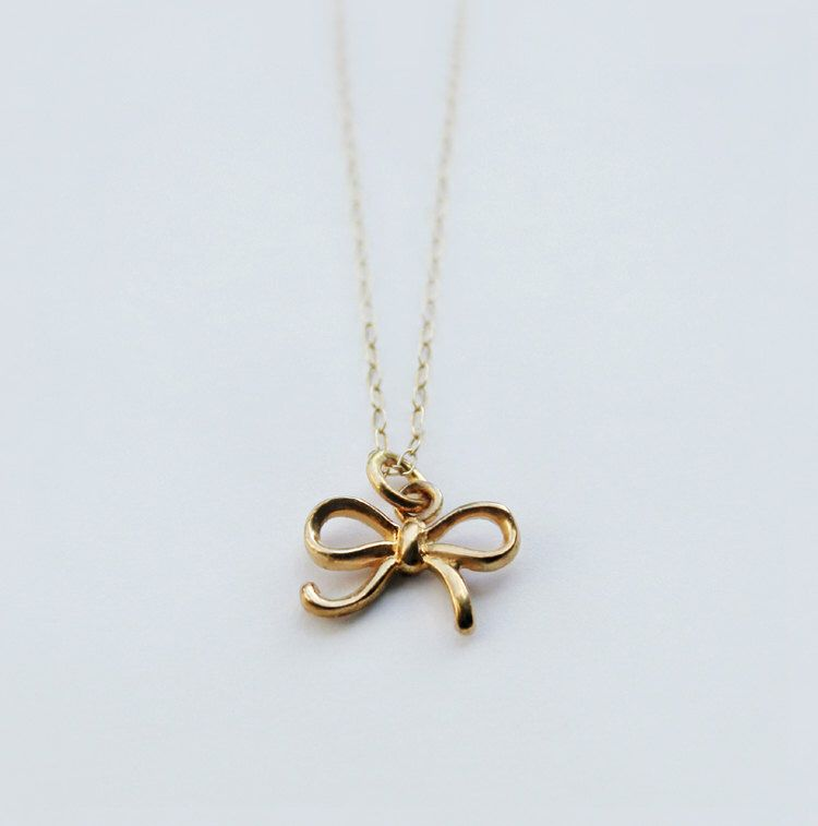 Tiny bow necklace - Dainty bow charm necklace - sterling silver or vermeil gold - Bridal wedding bridemaids favor - Small delicate bow by shopLUCA on Etsy https://www.etsy.com/listing/107520226/tiny-bow-necklace-dainty-bow-charm