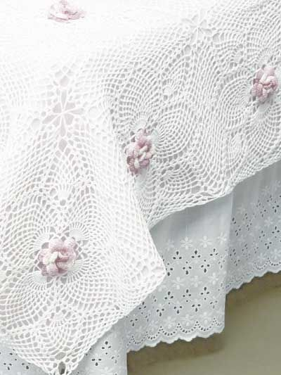 white crocheted bedspread with rose accents - wish pic was better - pinning because i have a tea-stained crochet bedspread that would dress up nicely with roses like this ...