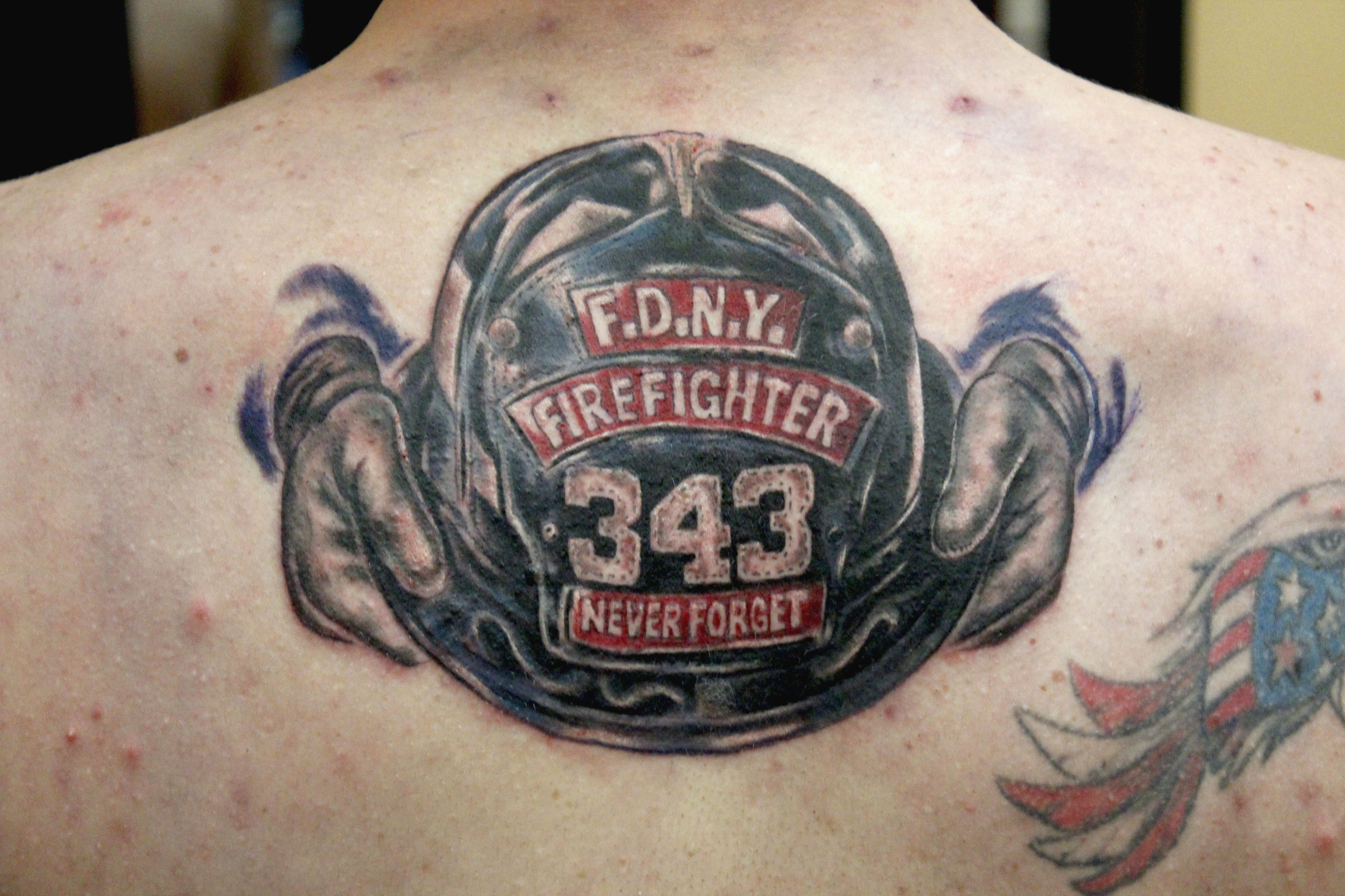 2c23ebaad F.D.N.Y. HELMET TRIBUTE TATTOO DONE BY SEAN AMBROSE AT ARROWS AND EMBERS  CUSTOM TATTOOING shared by NYC Firestore