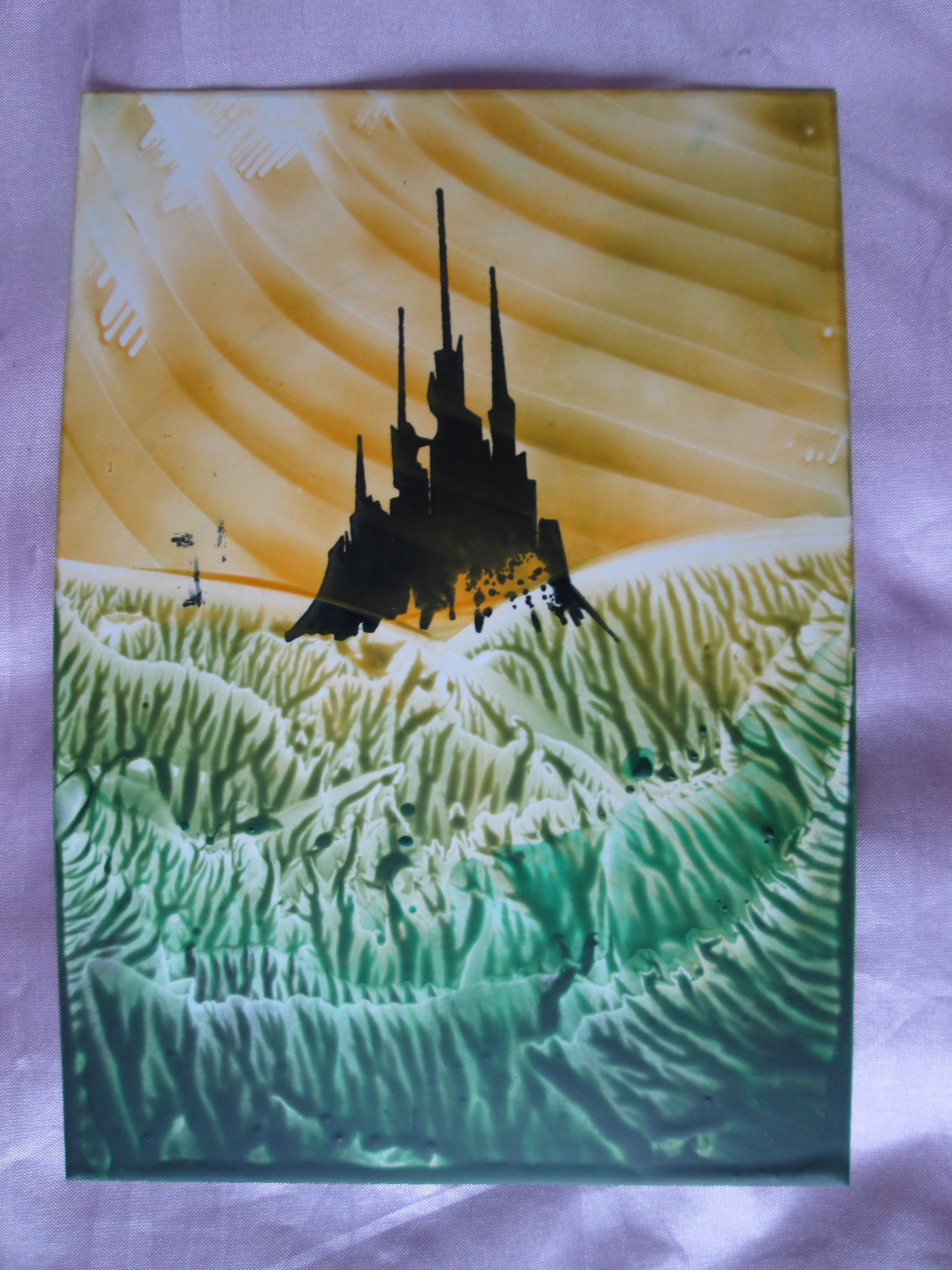 Encaustic wax art painting of a landscape with a castle. I used an ink stamper to create the castle silhoutte and then layered over coloured beeswax with a small flat iron. To see this on my etsy account visit:  https://www.etsy.com/uk/shop/GemmasFantasyCrafts?section_id=17678655&ref=shopsection_leftnav_1