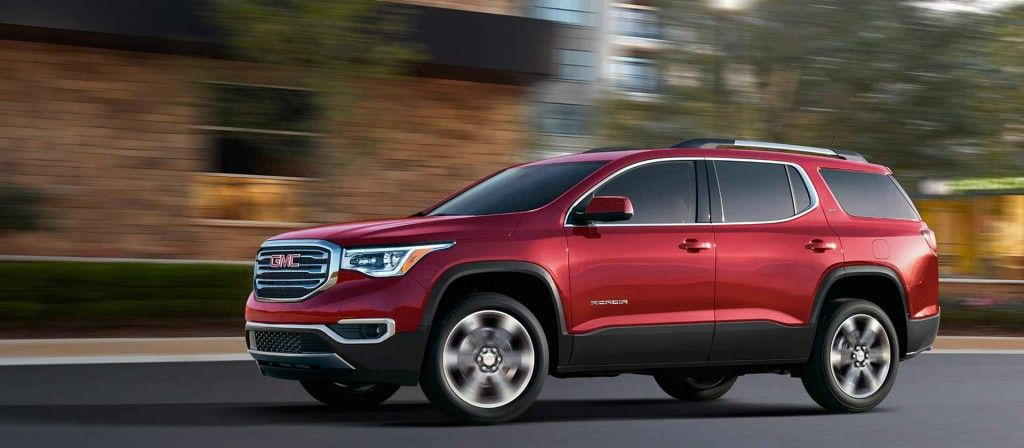 Image Showing A Side View Of The New 2017 Gmc Acadia Mid Size Suv Driving On The Road In Crimson Red Tincoat Mid Size Suv Most Reliable Suv New Cars